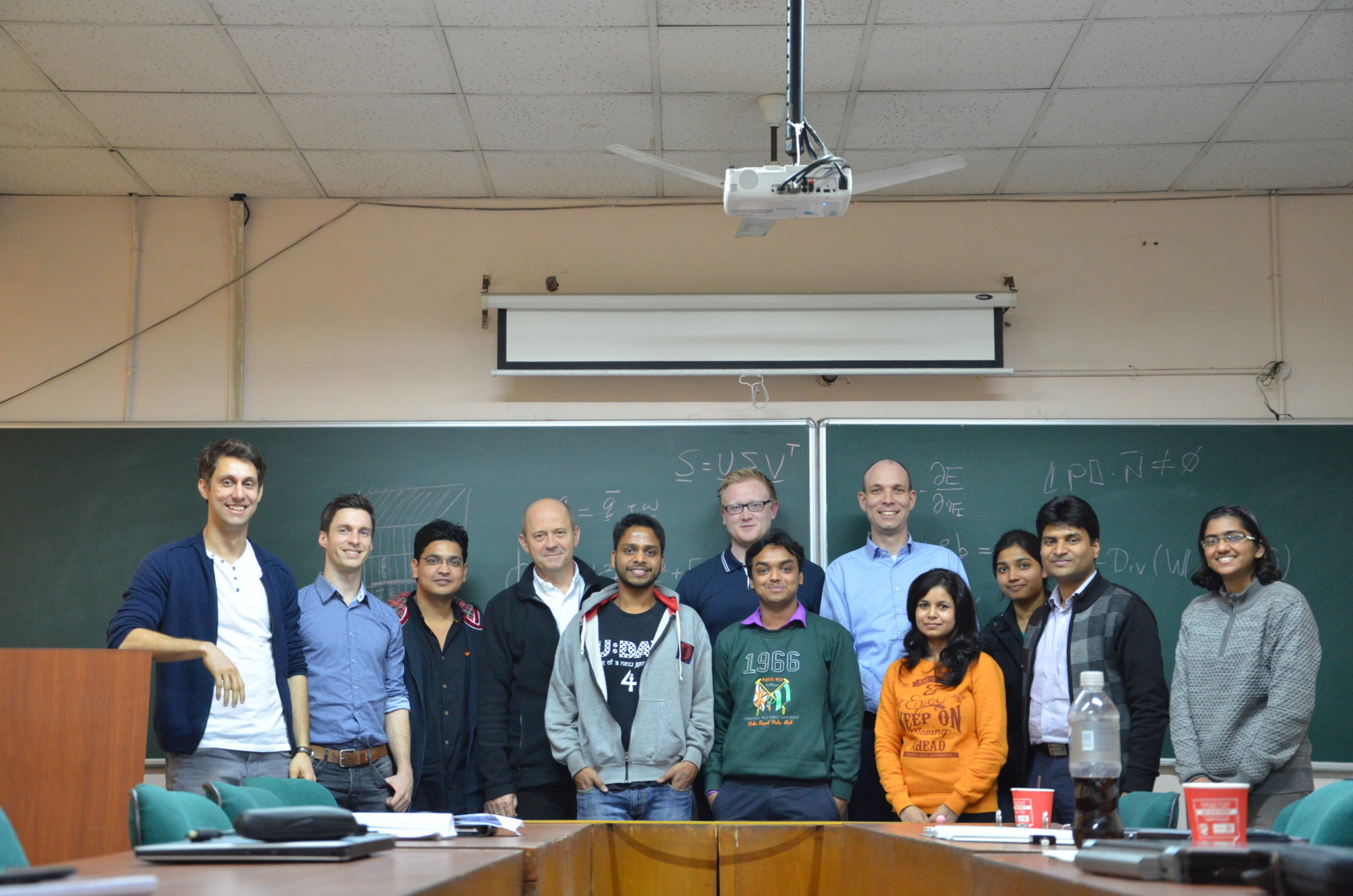 "Group photo of twelve researchers from the technical faculties at Friedrich-Alexander-Universität Erlangen-Nürnberg and the Indian Institute of Technology Delhi gathering for the workshop ""Multiscale and Multiphysics – Challenges in Continuum Mechanics"" in Delhi."