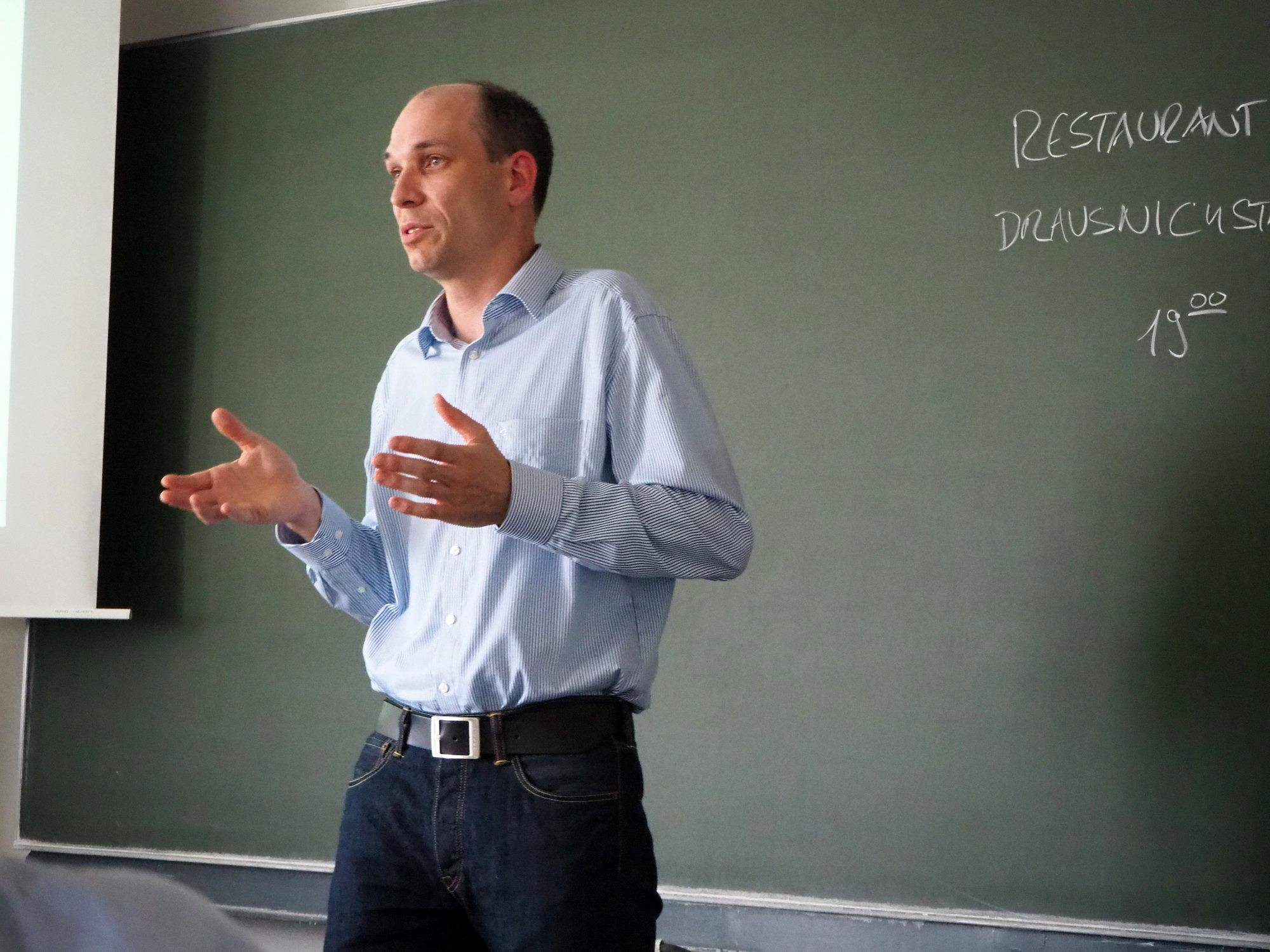 "Dr. Sebastian Pfaller giving a presentation on ""Simulating Polymers with the Multiscale Capriccio Method"" at Friedrich-Alexander-Universität Erlangen-Nürnberg."