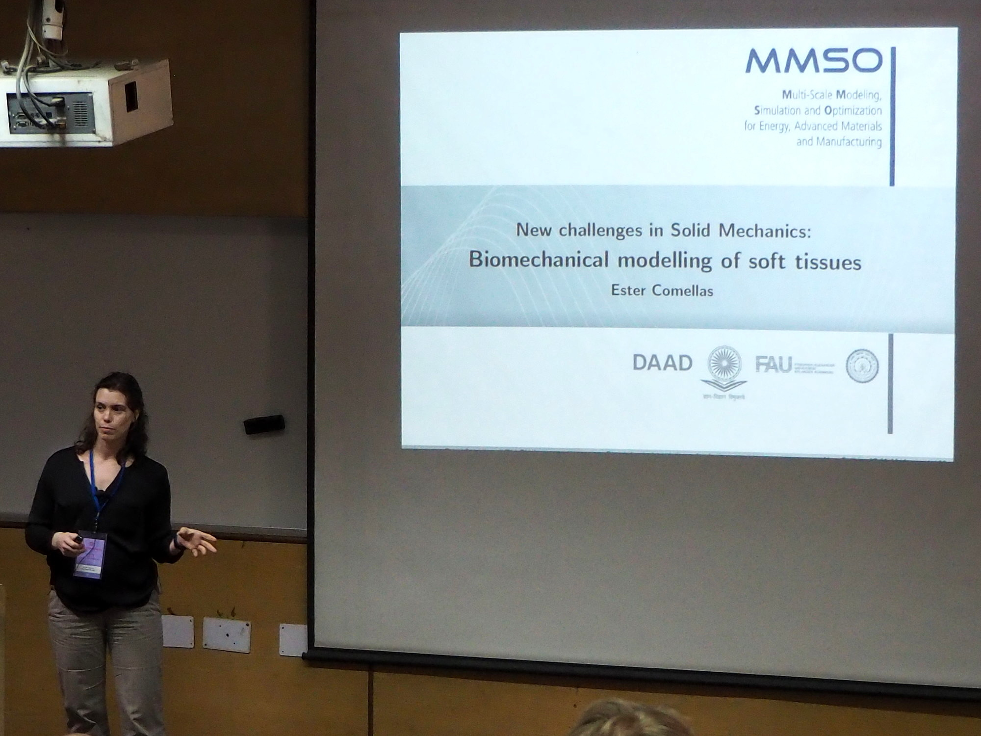 "Dr. Ester Comellas giving a presentation on ""Biomechanical modelling of soft tissues"" at the Indian Institute of Technology Delhi."