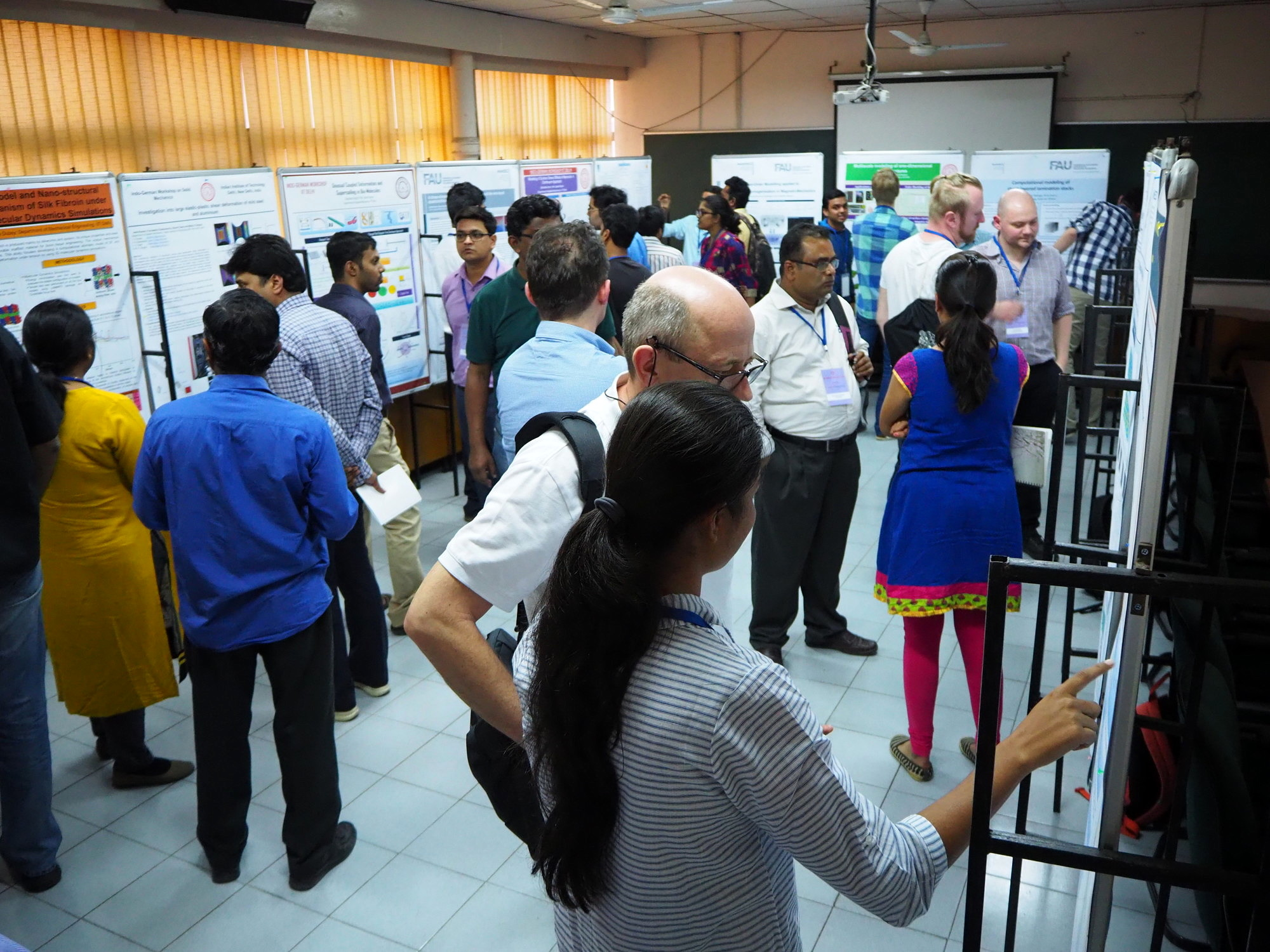 More than 20 people gathering to look at the posters that were part of the workshop at the Indian Institute of Technology Delhi.