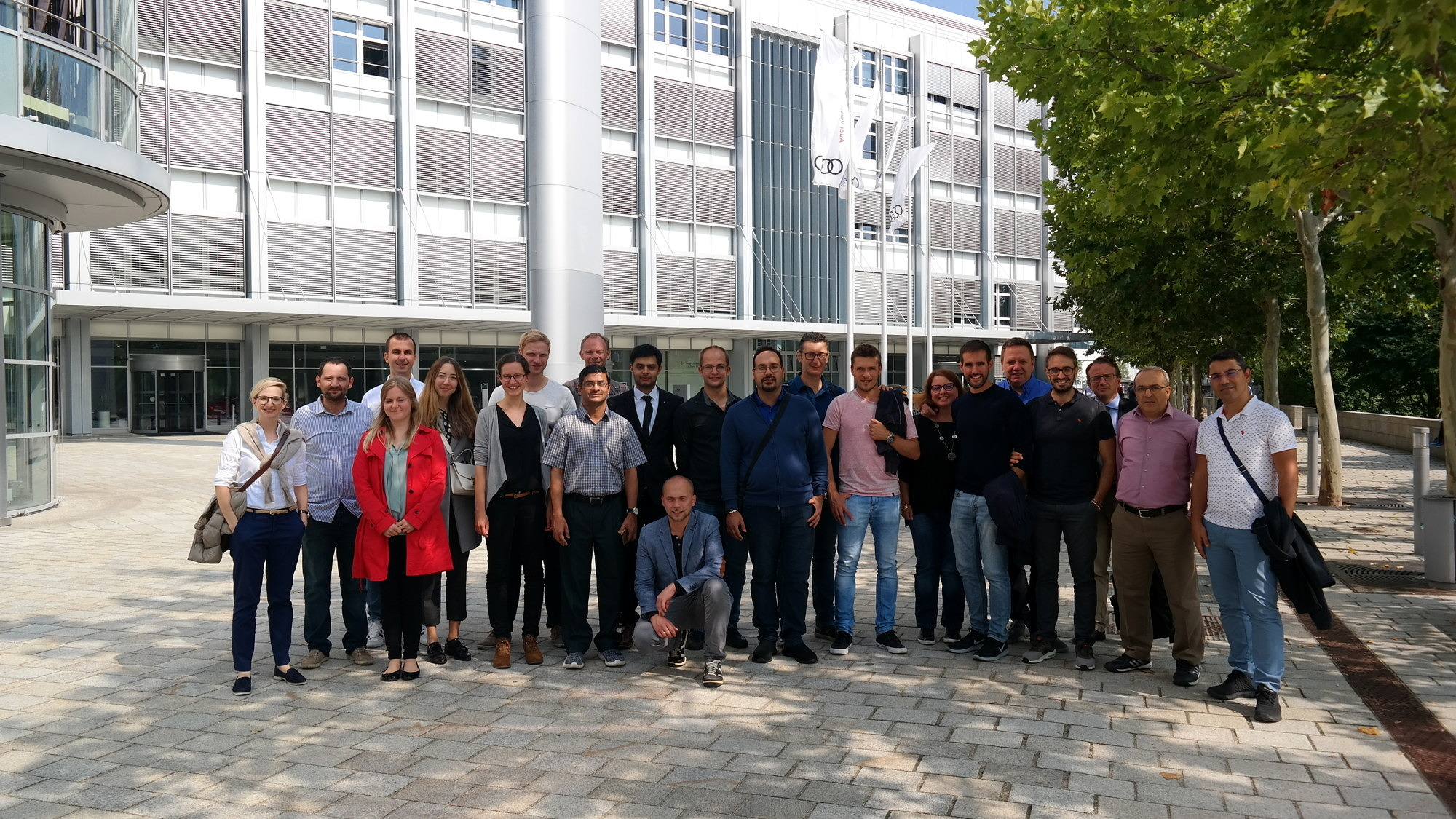 Group photo of 22 researchers from the technical faculties at Friedrich-Alexander-Universität Erlangen-Nürnberg and the Indian Institute of Technology Delhi visiting AUDI in Ingolstadt.